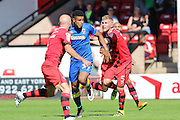 AFC Wimbledon striker Lyle Taylor (33) tussles with Walsall FC defender Jason McCarthy (5) during the EFL Sky Bet League 1 match between Walsall and AFC Wimbledon at the Banks's Stadium, Walsall, England on 6 August 2016. Photo by Stuart Butcher.