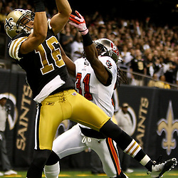 November 5, 2011; New Orleans, LA, USA; New Orleans Saints wide receiver Lance Moore (16) catches a touchdown over Tampa Bay Buccaneers cornerback E.J. Biggers (31) during the first quarter of a game at the Mercedes-Benz Superdome. Mandatory Credit: Derick E. Hingle-US PRESSWIRE