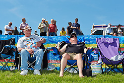 © Licensed to London News Pictures.  26/05/2013. PODINGTON, UK. Over 10,000 motorsports fans enjoy blue skies while watching dragsters compete in round 1 of FIA European Drag Racing Championship at the Santa Pod Raceway in Podington. The cars travel a quarter mile course in under 5 seconds reaching speeds of 300 miles an hour. Photo credit: Cliff Hide/LNP