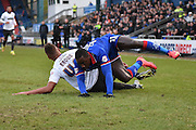 Oldham Athletic Forward, Dominic Poleon comes off worse after a Bury Defender, Reece Brown tackle during the Sky Bet League 1 match between Oldham Athletic and Bury at Boundary Park, Oldham, England on 23 January 2016. Photo by Mark Pollitt.