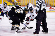 October 13, 2007 - Anchorage, Alaska: Sean Berkstresser (22) of the Robert Morris Colonials faces off with Stavros Paskaris (12) of the Wayne State Warriors as the Colonials take a 4-1 victory over the Wayne State Warriors at the Nye Frontier Classic at the Sullivan Arena.