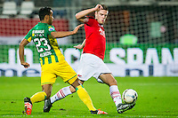 ALKMAAR - 04-12-2015, AZ - ADO Den Haag, AFAS Stadion, ADO Den Haag speler Roland Alberg, AZ speler Markus Henriksen raakt hier geblesseerd.