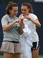 Ingrid Neel (right) and Louise Campos on Day Six of the Fuzion 100 Surbiton Trophy at the Surbiton Racket & Fitness Club, Surrey, United Kingdom.<br /> Picture by Daniel Hambury/Focus Images Ltd 07813022858<br /> 07/06/2018
