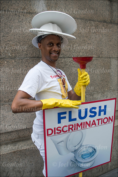 Before the start of the Gay Pride Parade, marcher poses for photo.  Flush Discrimination the right for transgenders to use public restrooms.<br /> <br /> Transgender denotes or relats to a person whose self-identity does not conform unambiguously to conventional notions of male or female gender