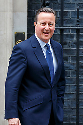 © Licensed to London News Pictures. 18/05/2016. London, UK. Prime Minister David Cameron leaving Downing Street to attend  the Queen's Speech at The Houses of Parliament as part of the State Opening of Parliament in London on Wednesday, 18 May 2016. Photo credit: Tolga Akmen/LNP