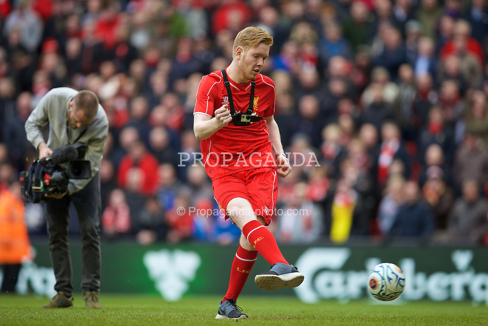 LIVERPOOL, ENGLAND - Sunday, March 1, 2015: A competition winner, wearing a GoPro camera, takes a penalty at the Kop end during the half-time interval during the Premier League match against Manchester City' at Anfield. (Pic by David Rawcliffe/Propaganda)