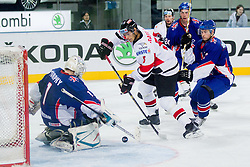 Stephen Murphy of Great Britain vs Thomas Raffl of Austria during ice-hockey match between Austria and Great Britain at IIHF World Championship DIV. I Group A Slovenia 2012, on April 16, 2012 in Arena Stozice, Ljubljana, Slovenia. Austria defeated Great Britain 6-3. (Photo by Vid Ponikvar / Sportida.com)