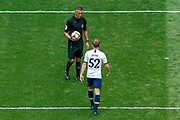 Tottenham Hotspur midfielder Oliver Skipp (52) collects the ball from Referee Andre Marriner before missing his penalty, penalty shootout, during the Pre-Season Friendly match between Tottenham Hotspur and Inter Milan at Tottenham Hotspur Stadium, London, United Kingdom on 4 August 2019.