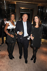 Left to right, PHOEBE VELA, ANDREW NEIL and CHARLOTTE SORATO at a party to celebrate the launch of a collection of jewellery by Tamara Ecclestoen for jewellers Moussaieff held at their store in New Bond Street, London on 9th December 2008.