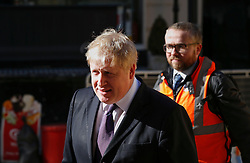 © Licensed to London News Pictures. 23/02/2016. London, UK. Mayor of London BORIS JOHNSON leaves Crossrail construction site near Bond Street in central London after attending a visit by Queen Elizabeth II. Photo credit: Peter Macdiarmid/LNP