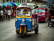 29 NOVEMBER 2015 - BANGKOK, THAILAND:  A tuk-tuk, or three wheeled taxi, in the Amulet Market on Maharat Road in Bangkok. Hundreds of vendors used to sell amulets and Buddhist religious paraphernalia to people in the Amulet Market, a popular tourist attraction along Maharat Road north of the Grand Palace near Wat Maharat in Bangkok. Bangkok municipal officials announced that they are closing the market and forcing vendors to relocate to an area about one hour outside of Bangkok. The closing of the amulet market is the latest in a series of municipal efforts to close and evict street vendors and markets from areas that have potential for redevelopment. The street vendors were evicted from the area on Sunday, Nov. 29.      PHOTO BY JACK KURTZ