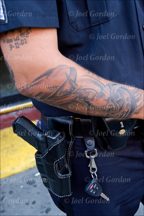 NYPD police officer wearing short sleeves uniform with tattoos on his arms.  Officer is grandfathered joined the police force before 2007. After 2007 he would have to cover up his tattoos.  His assignment that day was to cover crowd control in Williamsburg, Brooklyn NY