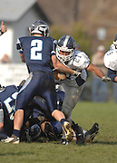John Glenn's Antony Merchant (21) gets tackled by Petoskey's Quinn Ameel (2) during the Bobcat's district playoff loss to the Petoskey Northmen.