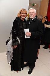 SIR DEREK JACOBI and SAMANTHA BOND at a pre party for the English National Ballet's Christmas performance of The Nutcracker was held at the St.Martin's Lane Hotel, St.Martin's Lane, London on 12th December 2013.