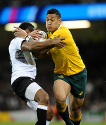 Australia Full Back Israel Folau evades the tackle of Fiji replacement Asaeli Tikoirotuma  - Mandatory byline: Joe Meredith/JMP - 07966386802 - 23/09/2015 - Rugby Union, World Cup - Millenium Stadium -Cardiff,Wales - Australia v Fiji - Rugby World Cup 2015 - Pool A