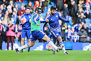 Chelsea's Diego Costa & Chelsea's César Azpilicueta warming up during the The FA Cup third round match between Chelsea and Scunthorpe United at Stamford Bridge, London, England on 10 January 2016. Photo by Shane Healey.