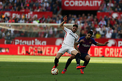 February 23, 2019 - Seville, Madrid, Spain - Sergi Gomez (Sevilla FC) and Luis Suarez (FC Barcelona) are seen in action during the La Liga match between Sevilla FC and Futbol Club Barcelona at Estadio Sanchez Pizjuan in Seville, Spain. (Credit Image: © Manu Reino/SOPA Images via ZUMA Wire)
