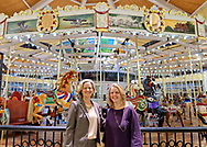 Garden City, New York, USA. March 9, 2019.  L-R. Nassau County Executive LAURA CURRAN and Nassau County Legislator Debra Mulé (5th L.D.) pose in front of carousel during Unveiling Ceremony of mural of Nunley's Carousel lead horse. Event was held at historic Nunley's Carousel in its Pavilion on Museum Row on Long Island.