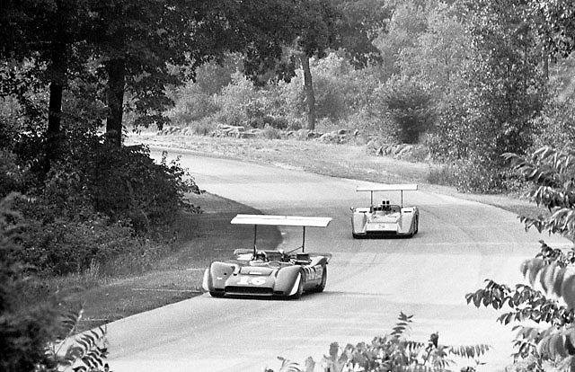 Chris Amon in Ferrari 612P ahead of Denny Hulme's McLaren M8B at Road America, Elkhart Lake in 1969
