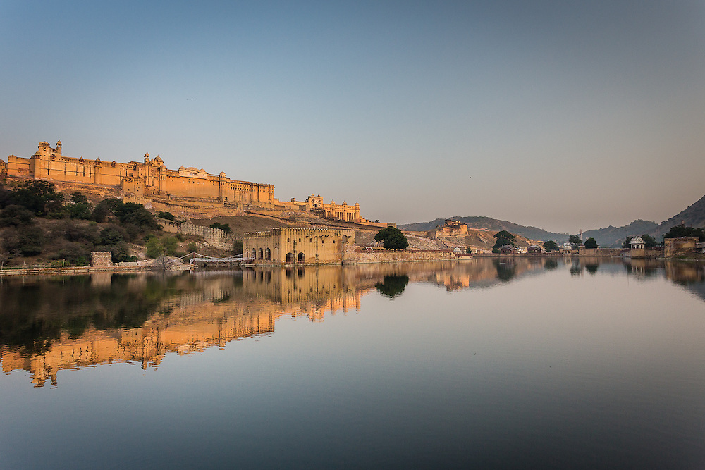 Amber Palace is reflected in the calm waters of the nearby river, in the early morning.