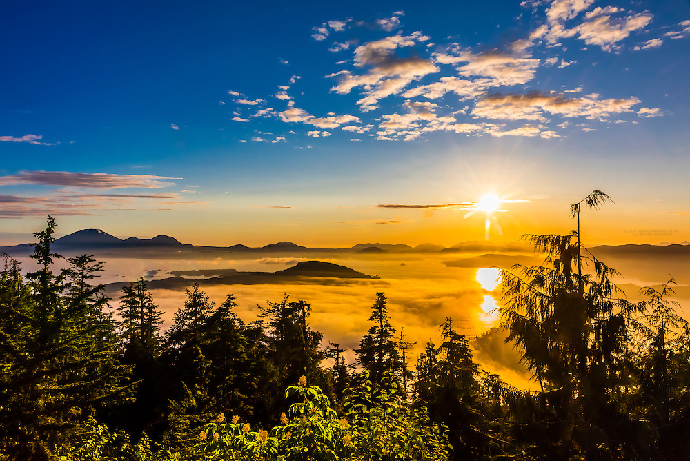 Overview from Harbor Mountain at sunset, Sitka (on Baranof Island), Alaska USA with islands including Kruzof Island off shore.