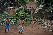 Young men playing basketball in Malucano.