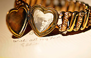 A bracelet containing a photograph of a US Navy veteran was left with his fiance while he served overseas during WWII.  An Easter card sent to his fiance during his deployment overseas professes his love.