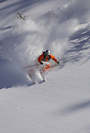 Skier turning in fresh powder snow, Monetier, Serre Chevalier ski resort, France.
