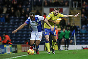 Blackburn Rovers Defender ,  Ryan Nyambe  (24) and Leeds United midfielder Stuart Dallas (15)  battle during the EFL Sky Bet Championship match between Blackburn Rovers and Leeds United at Ewood Park, Blackburn, England on 2 February 2017. Photo by Pete Burns.