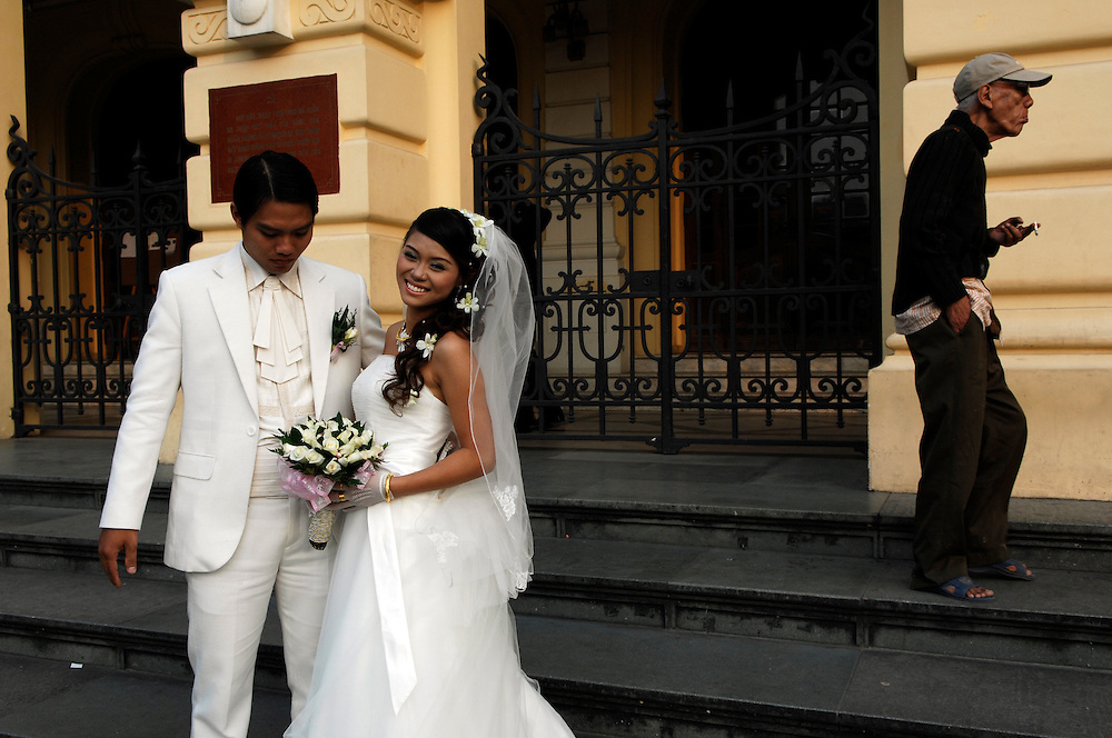 Hanoi:Newlyweds have their photographs taken on the steps of the French built Opera House