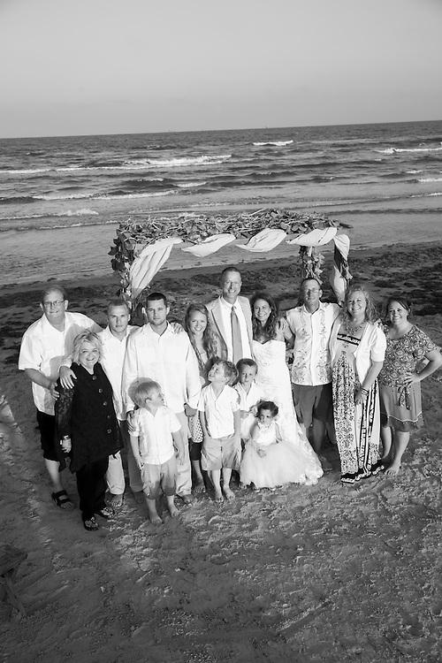 A beach wedding photographed in Port Aransas, Texas by Tim Burdick Photography.