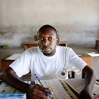 Dar Es Salaam, Tanzania 31 October 2010<br /> A polling station officer in charge of giving the voting forms to the citizens poses for the photographer.<br /> The European Union has launched an Election Observation Mission in Tanzania to monitor the general elections, responding to the Tanzanian government invitation to send observers for all aspects of the electoral process.<br /> The EU sent this observation mission led by Chief Observer David Martin, a member of the European Parliament. <br /> PHOTO: EZEQUIEL SCAGNETTI