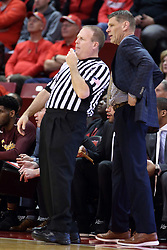 10 January 2018:  Gerry Pollard leans back to listen to Porter Moser during a College mens basketball game between the Loyola Chicago Ramblers and Illinois State Redbirds in Redbird Arena, Normal IL