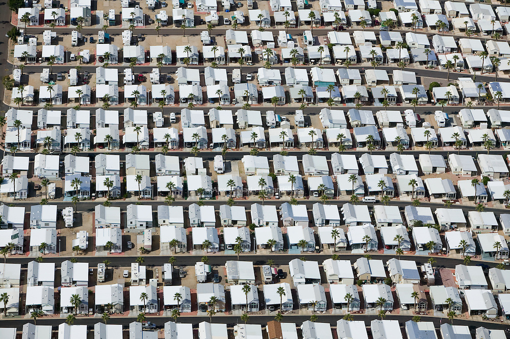 More than 22 million Americans live in mobile homes.   Despite the name, many are virtually permanent, because they have structural additions such as decks or carports or are older and fail to meet the contemporary building codes established in most areas.  Often, they are the only way that a family can afford a home of their own.