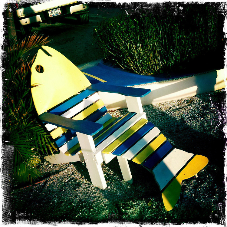 """Adirondack chair at The Bridgewater Inn. Matlacha (pronounced """"MAT-la-shay"""") is located about two hours south of Tampa Bay on Pine Island and is a mix of Key West meets Old Florida fishing village. """"We're a quaint little drinking village with a fishing problem,"""" laughs a local who goes by the name Bear..Photos by James and Julie Branaman"""