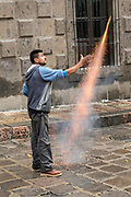 A fireworks worker sets off a bottle rocket ahead of a procession through the historic city during the week long fiesta of the patron saint Saint Michael September 24, 2017 in San Miguel de Allende, Mexico.