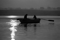 India, Varanasi, 1999. Two brothers row on the Ganges in the magic light of early morning. In winter, the great, wide river is at its slowest and most peaceful.