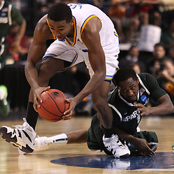 Mar 17, 2011; Tampa, FL, USA; UCLA Bruins guard Malcolm Lee (3) steals the ball from Michigan State Spartans guard Matt Heneveld (3) during the second half of the second round of the 2011 NCAA men's basketball tournament at the St. Pete Times Forum. UCLA defeated Michigan State 78-76.  Mandatory Credit: Derick E. Hingle