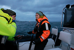 NORWAY ANDENES 8DEC15 - Greenpeace campaigners Larissa Baeumer of Germany and Erlend Tellnes (L) of Norway during a whale research boat trip off the coast of Andenes, Norway.<br /> <br /> jre/Photo by Jiri Rezac / Greenpeace<br /> <br /> © Jiri Rezac 2015