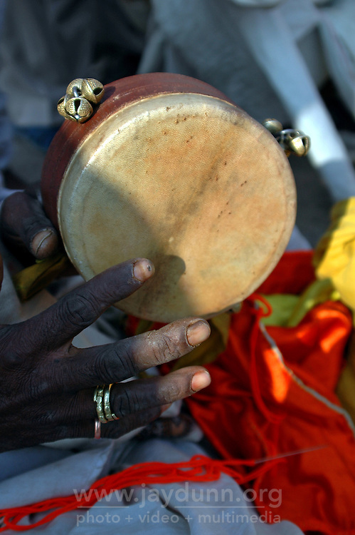 "India, Nasik, 2006. ""Sadhus,"" or traveling holy men, play religious music by the banks of the Godavari River, a pilgrimage site for many Hindus."