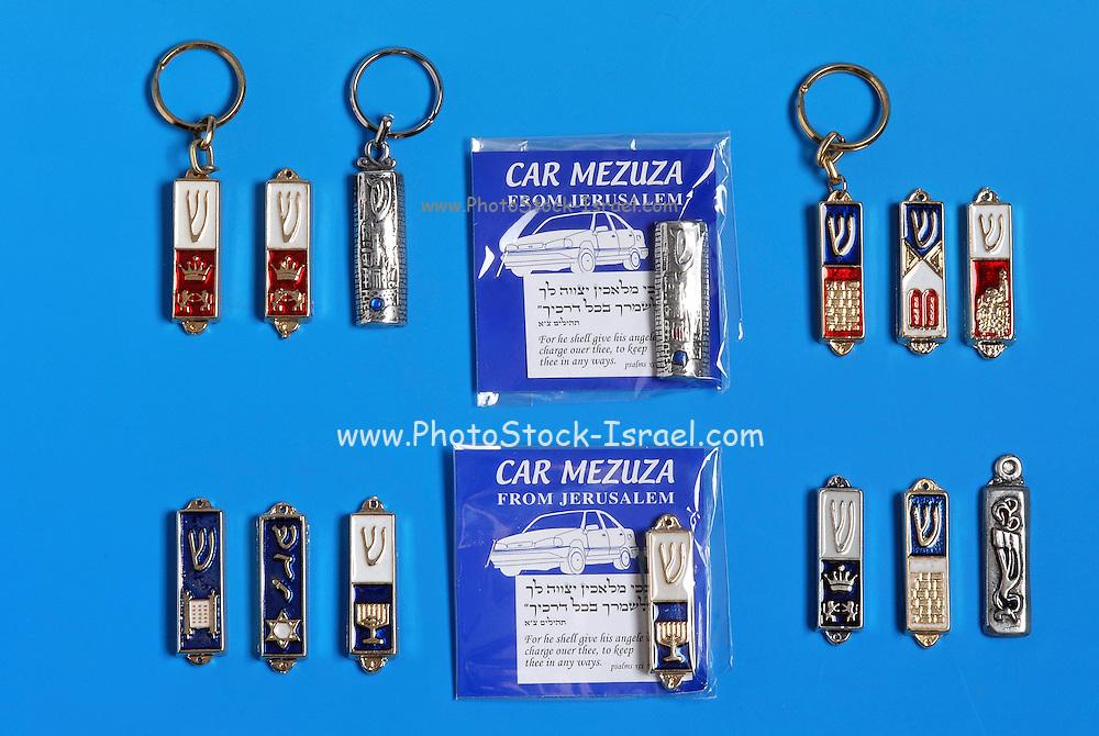 Keyring Mezuza Israeli amulets and souvenirs on blue background