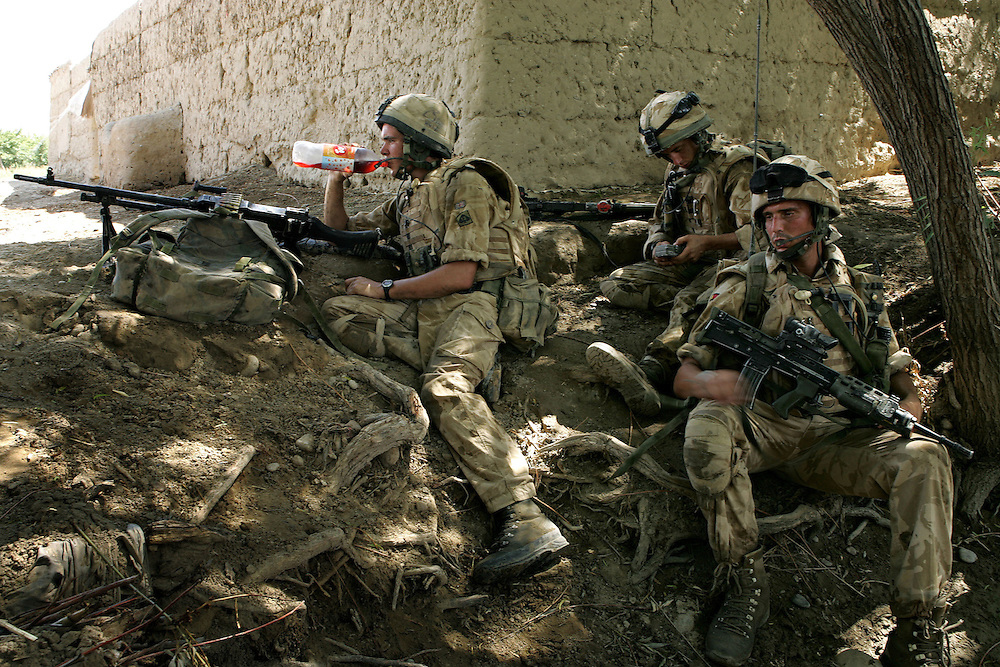 29/06/07..Sangin Valley, Helmand, Afghanistan..Soldiers from A Company 1 Battalion Royal Anglians, known as 'The Vikings' take a rest break whilst conducting operations against the Taliban in the Sangin Valley, Helmand province, Afghanistan on the 29th June 2007...The soldiers made a Tactical Advance to Battle over night carrying just food, water and ammunition. At first light they moved on their objectives; a series of compounds, orchards and paddy fields. During the day they exchanged fire with the enemy on a number of occasions. 13 Taliban were killed, 1 British soldier and 3 Afghan troops were wounded.