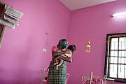 CHENNAI, INDIA, JULY 2012:.volunteer takes care of children newly arrived in the drop off center terres des homme, where mothers do not want to keep the kids can turn and make sure that all children will have the best care of the case.,july 2012.© Giulio Di Sturco