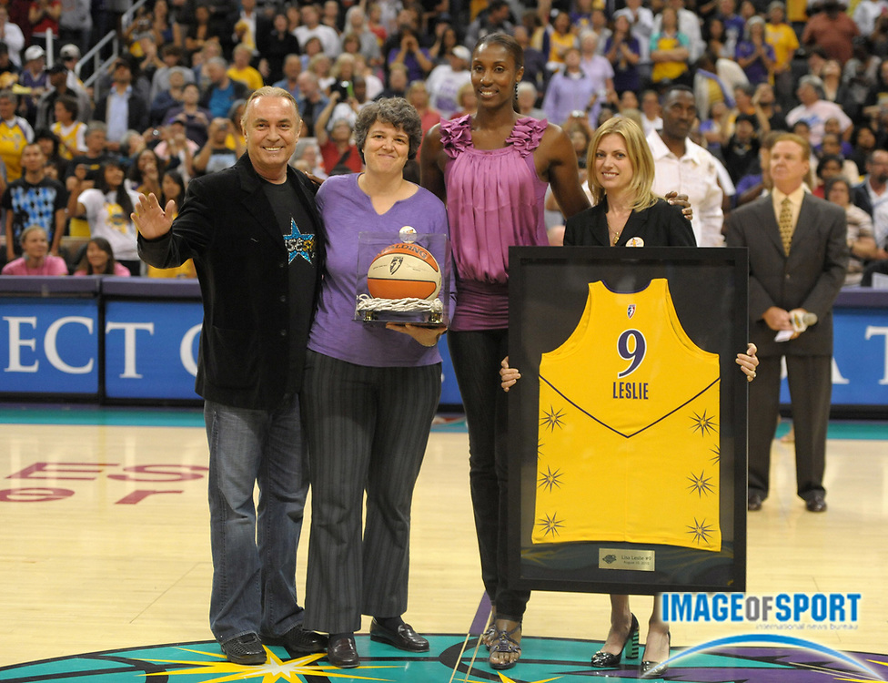 Aug 10, 2010; Los Angeles, CA, USA; Los Angeles Sparks former player Lisa Leslie (second from right) at halftime ceremony to retire her No. 9 jersey during the game against the Indiana Fever at the Staples Center. From left: Johnny Buss, Kathy Goodman, Leslie and Carla Christofferson. Photo by Image of Sport