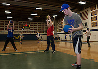Braedon Lacroix and his teammates work on conditioning skills for the upcoming baseball season in the Gilford High School gym Friday afternoon.  (Karen Bobotas/for the Laconia Daily Sun)