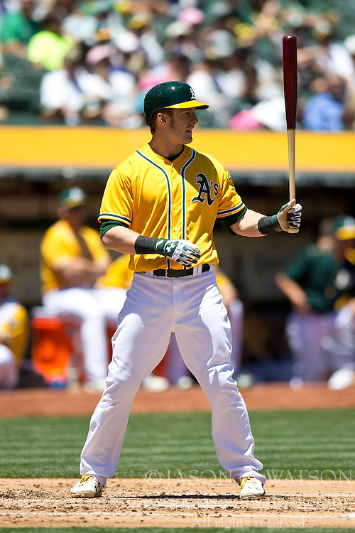 OAKLAND, CA - JUNE 18:  Mark Canha #20 of the Oakland Athletics at bat against the San Diego Padres during the second inning at O.co Coliseum on June 18, 2015 in Oakland, California. The San Diego Padres defeated the Oakland Athletics 3-1. (Photo by Jason O. Watson/Getty Images) *** Local Caption *** Mark Canha