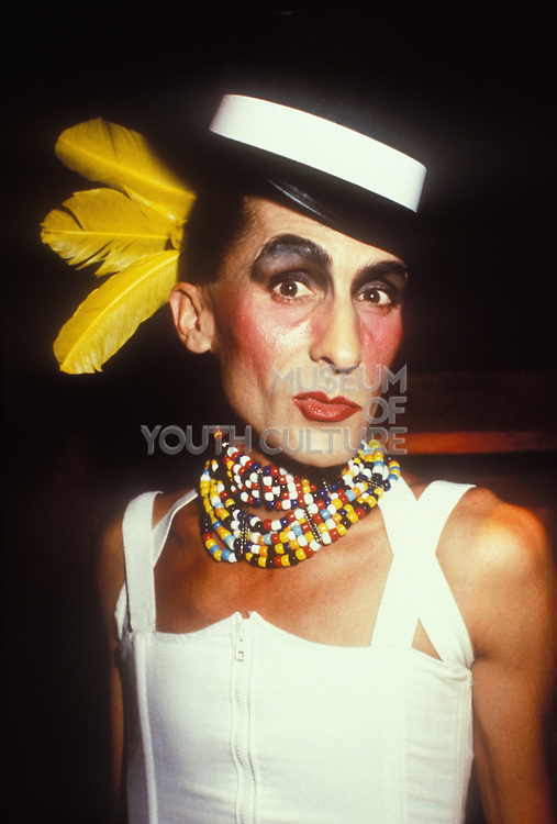 A cross-dressing man in dress, multi-coloured scarf and sailer's hat, Ibiza, 1998.