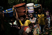 KABALA, SIERRA LEONE - Women carry buckets to fill water at Ismaia village, five miles from Kabala city on November 11, 2017 in Kabala, Sierra Leone. Photo by Xaume Olleros / MSF