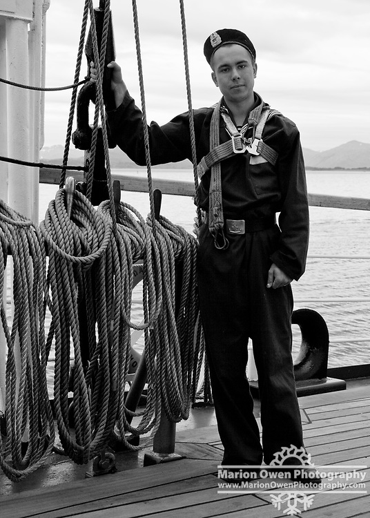 Portrait of Russian cadet sailor aboard Russian three-masted, square-rigged sailing training ship PALLADA during Kodiak, Alaska stopover on her transoceanic expedition celebrating the 270th anniversary of Russian America exploration by Russian seafarers; summer