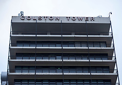 "© Licensed to London News Pictures; 11/06/2020; Bristol, UK. The words ""Colston Tower"" can be seen on one side of Colston Tower after contractors removed the letters from the other side of the office block in the city centre, following renewed controversy over the name of 17th century slave trader and Bristol philanthropist Edward Colston. At a Black Lives Matter protest the previous Sunday the statue of slave trader Edward Colston which has stood in Bristol city centre for over 100 years was pulled down with ropes and thrown in Bristol Docks by protesters during the BLM rally and march through the city centre in memory of George Floyd, a black man who was killed on May 25, 2020 in Minneapolis in the US by a white police officer kneeling on his neck for nearly 9 minutes. Edward Colston (1636 – 1721) was a wealthy Bristol-born English merchant involved in the slave trade, a Member of Parliament and a philanthropist. He supported and endowed schools, almshouses, hospitals and churches in Bristol, London and elsewhere, and his name is commemorated in several Bristol landmarks, streets, three schools and the Colston bun. The killing of George Floyd has seen widespread protests in the US, the UK and other countries. Photo credit: Simon Chapman/LNP."